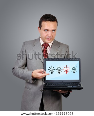 businessman with laptop in hand, idea concept
