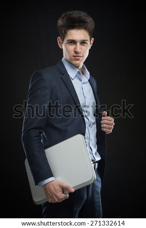 businessman with laptop in the studio - stock photo