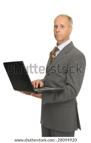 Businessman with laptop isolated in white