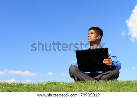 businessman with laptop looking up