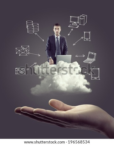 Businessman with laptop on cloud with hand drawn technology icons and hand. - stock photo