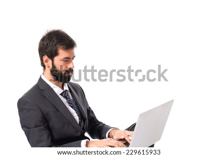 Businessman with laptop over isolated white background