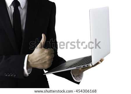 businessman with laptop showing thumb up gesture - stock photo