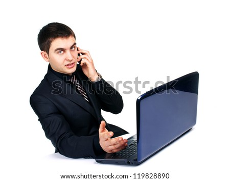businessman with laptop talking on a mobile phone