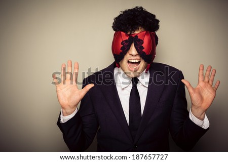 Businessman with lingerie on his face is caught committing adultery