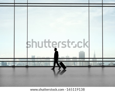 businessman with luggage walking  in airport  walking with luggage - stock photo