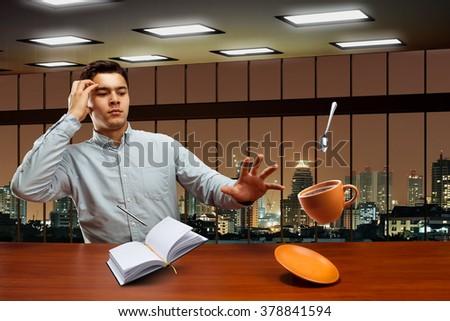 Businessman with magic - stock photo