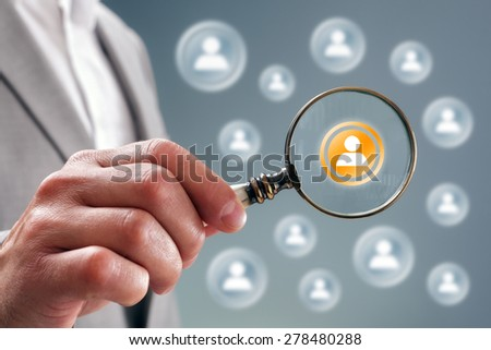 Businessman with magnifying glass on team personnel or contact icon concept for recruitment, social media, network, community and  internet marketing - stock photo