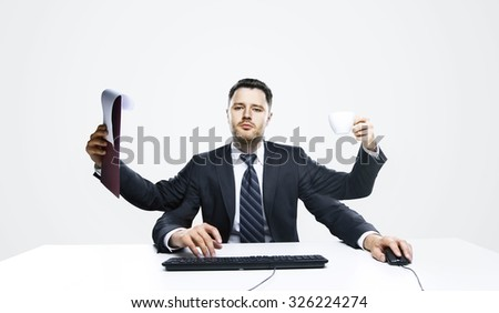 businessman with many hands on table working - stock photo