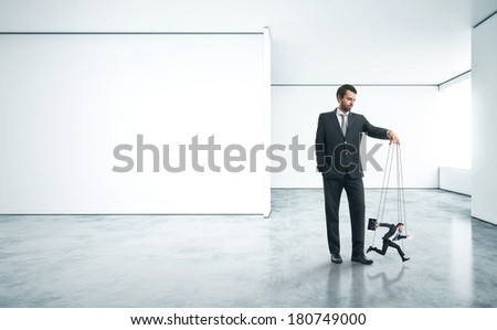 Businessman with marionette - stock photo