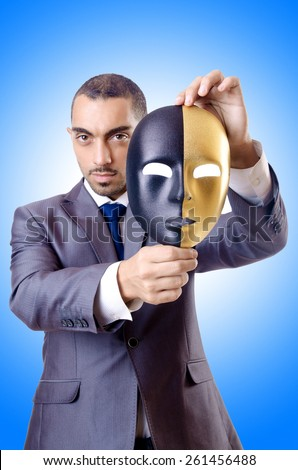 Businessman with mask in hypocrisy concept - stock photo