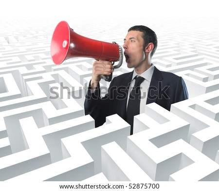 businessman with megaphone in a 3d labyrinth - stock photo