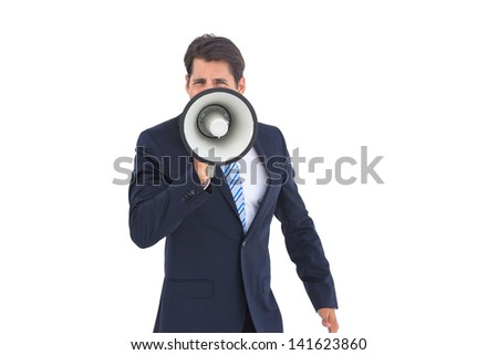 Businessman with megaphone on a white background
