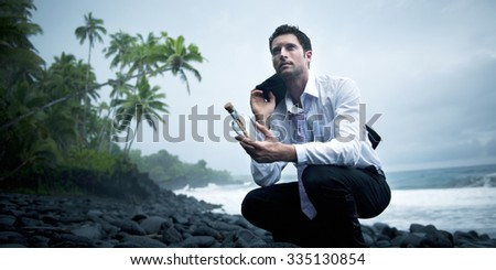 Businessman with Message in a Bottle Concept - stock photo