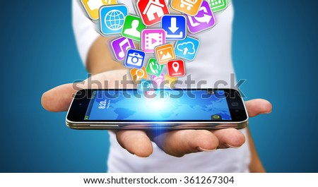 Businessman with modern mobile phone in his hand and applications flying over