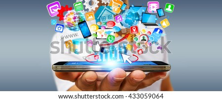 Businessman with modern mobile phone in his hand and applications icons flying over '3D rendering'