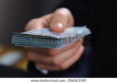 businessman with money - stock photo
