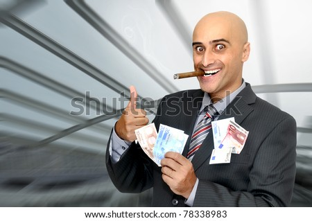 Businessman with money and a cigar