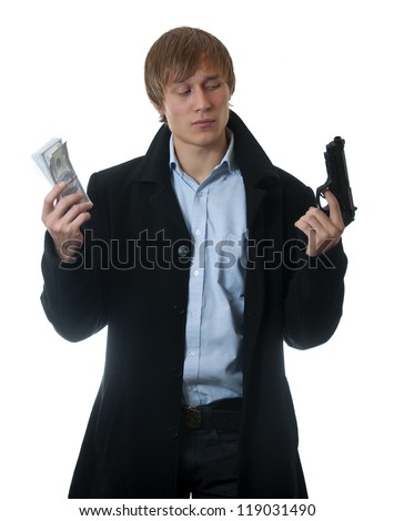 businessman with money and gun in hands