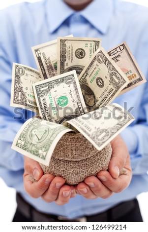 Businessman with money bag full of dollar banknotes - closeup - stock photo