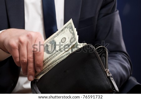 Businessman with money in hands.