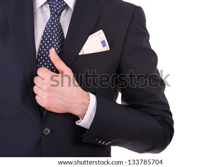 Businessman with money in suit pocket. - stock photo