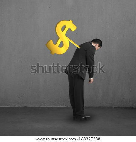 Businessman with money symbol winder on his back concrete building interior background
