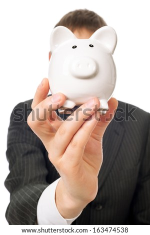 Businessman with moneybox in front of his head isolated on white. - stock photo