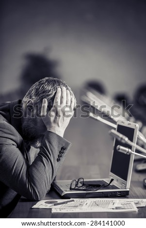 businessman with montney a big beard in a panic and depression has her head - stock photo