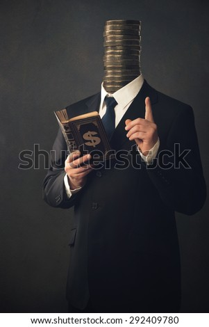 Businessman with moral pointing finger and the handbook for making money - stock photo