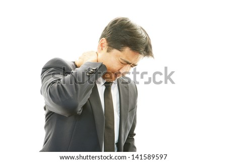 Businessman with neck pain.