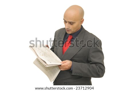 Businessman with newspaper isolated against a white background