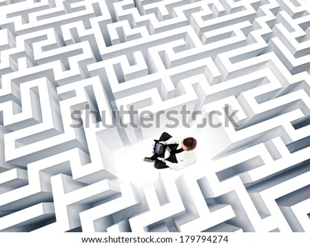 businessman with notebook and 3d maze - stock photo