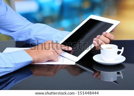 Businessman with notebook close-up - stock photo