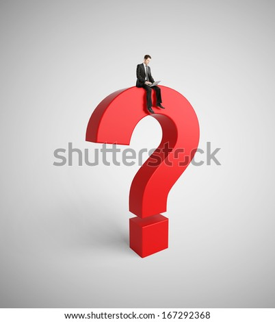 businessman with notebook sitting on red question mark