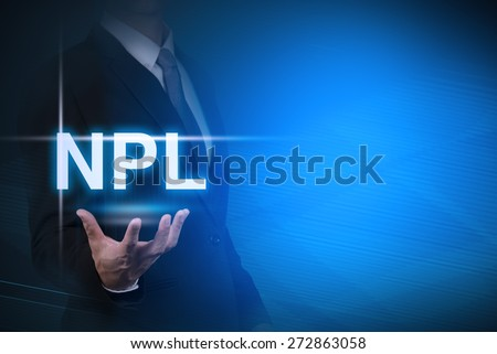 businessman with NPL word stand for Non Performing Loan on abstract background .key for business - stock photo