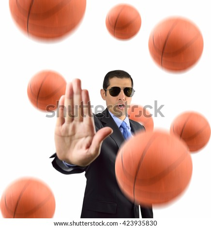 businessman with open palm gesturing to stop basketball on white background - stock photo