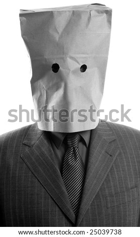 Businessman with paper bag in head - stock photo