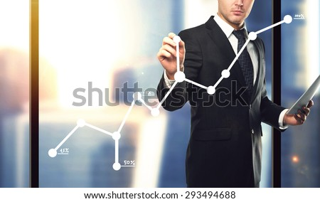 businessman with paper in hand drawing graph, close up - stock photo