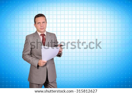 businessman with paper standing near blank plasma panel