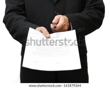 Businessman with pen and contract - stock photo