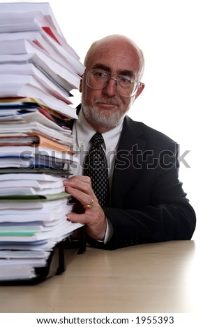 Businessman with pile of paperwork