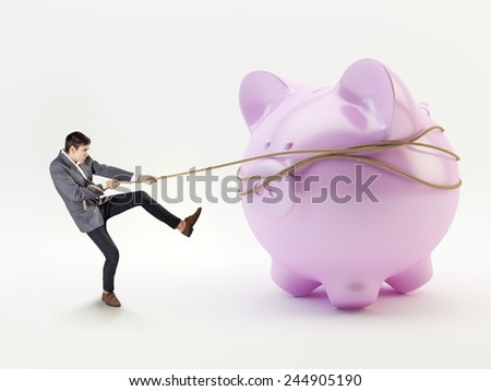 Businessman with pink piggy bank concept - stock photo