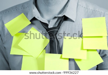 Businessman with plenty of post it notes