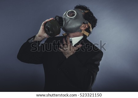 Businessman with protective mask, concept business dangerous for the environment or for society