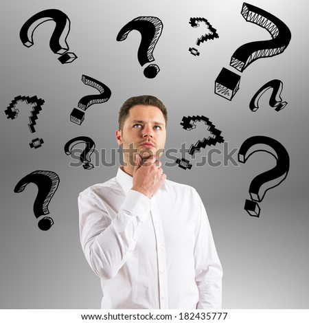 businessman with question mark  on a gray background
