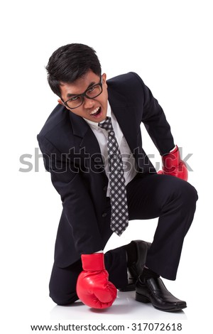 Businessman with red boxing gloves on white background