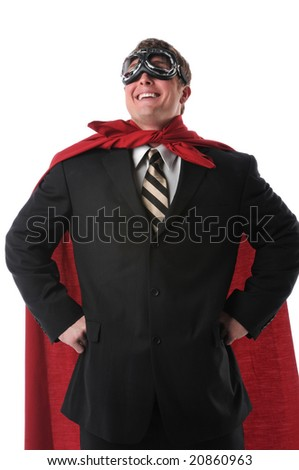 Businessman with red cape and goggles smiling confidently - stock photo
