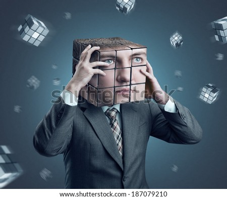 Businessman with rubik cube head - stock photo