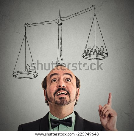 businessman with scale above head has idea solution one man weighting more than group off business people on balance. Power opinion leadership self importance ego concept. Face expression, emotion  - stock photo